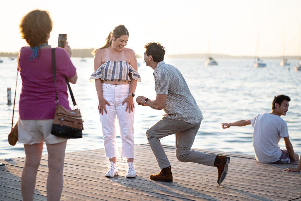 man proposing to woman by Mendota lake