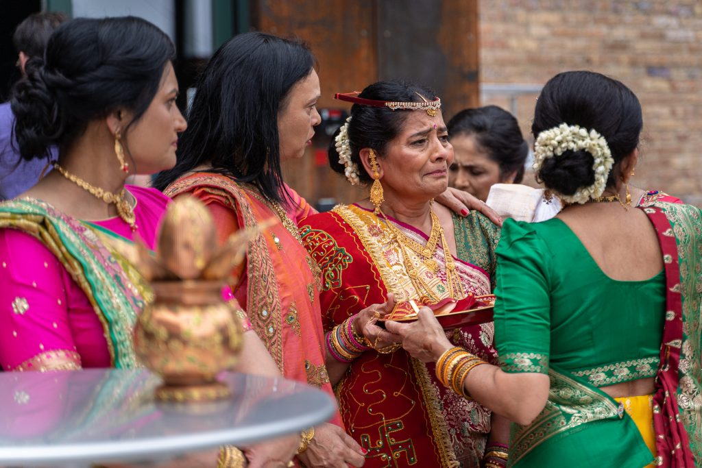 mother of the bride waiting for groom baraat