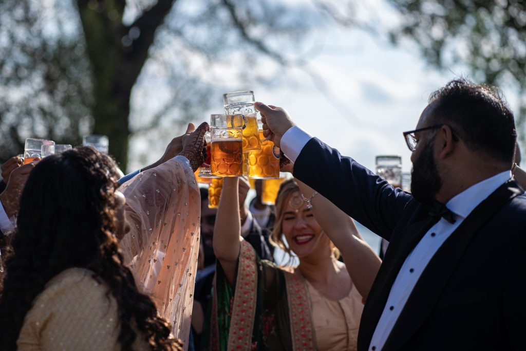 wedding party cheers at The Biergarten at Olbrich Park