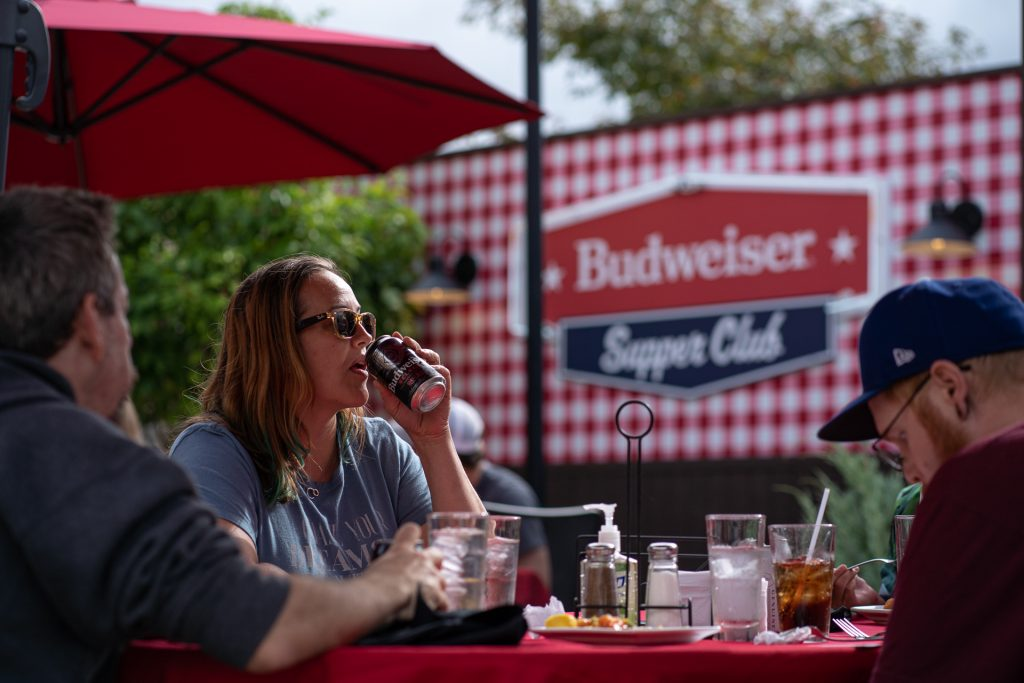 woman drinking budweiser