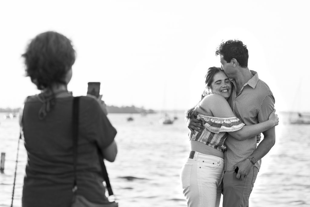 woman hugging man engagement photography