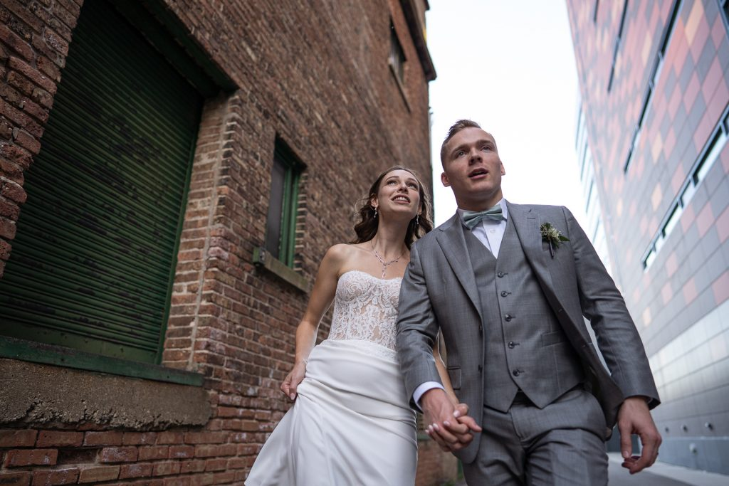 bride and groom walking in a madison wi alley