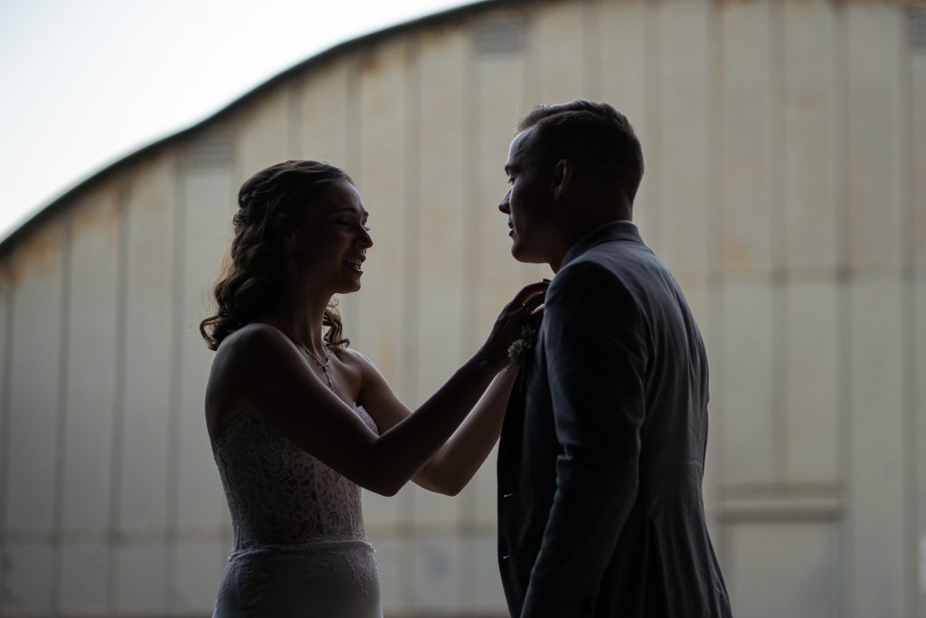 bride fixing grooms bow tie