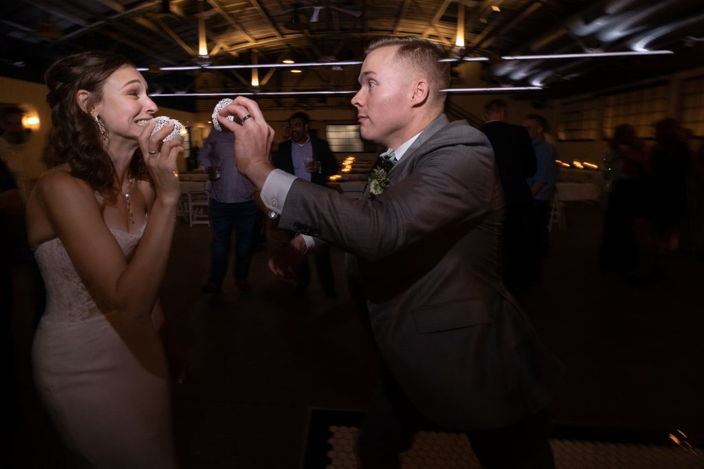couple smashing cupcakes at each others face