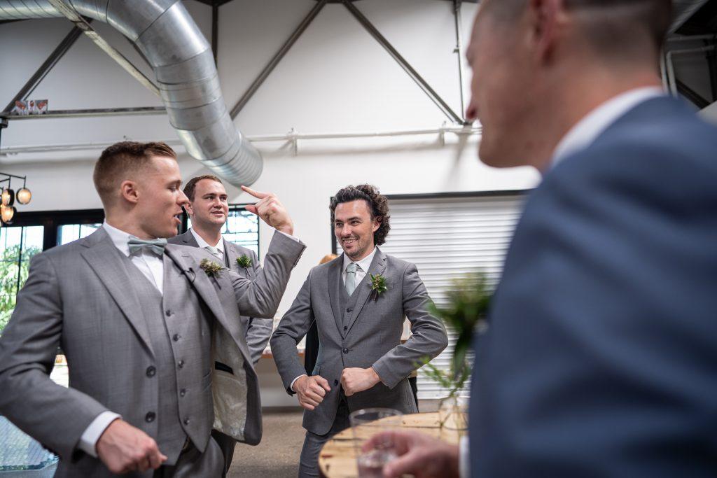 groom and groomsmen joking around