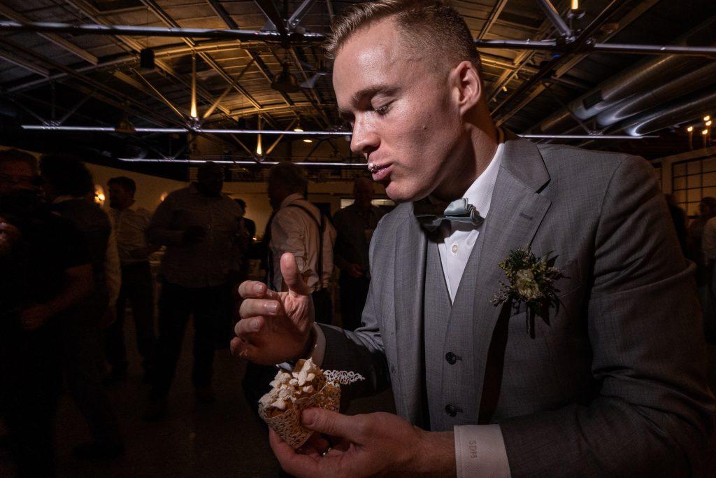 groom eating cupcake